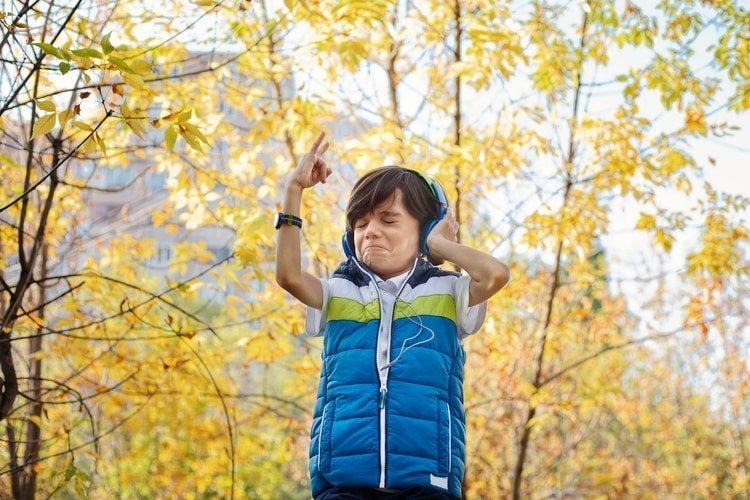 boy wearing watch and headphones