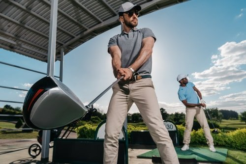 golfer at driving range with clubs