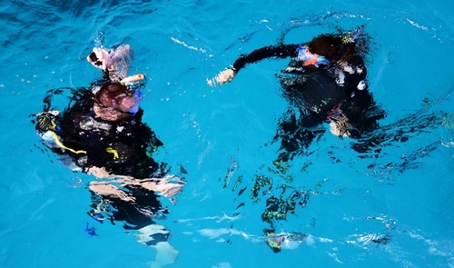 Pair of divers preparing for a dive