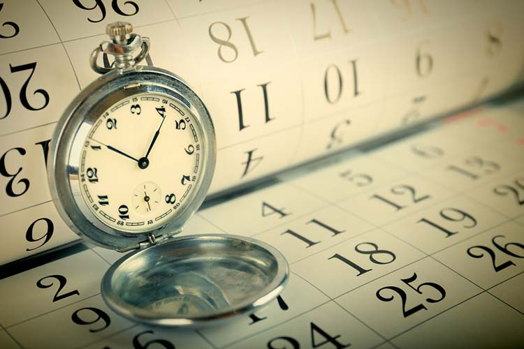 Old pocket watch and calendar