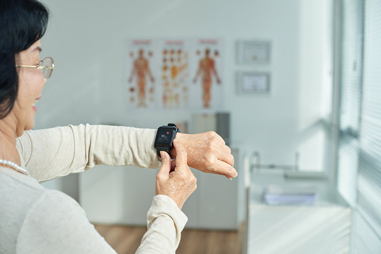 Senior Woman checking pulse rate