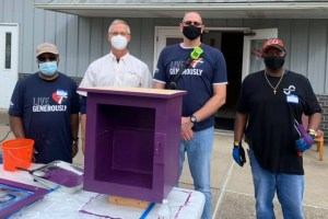 4 adults with unfinished little library box