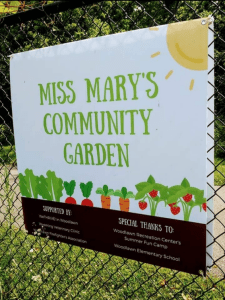 sign that says miss mary's community garden