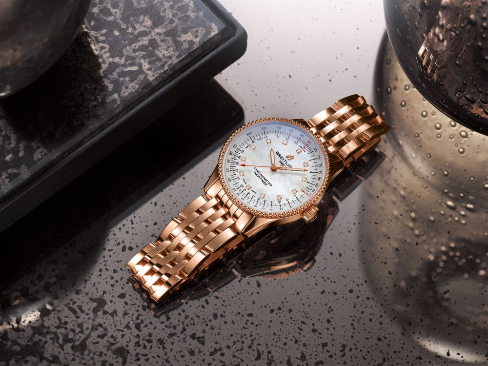 13 Navitimer Automatic 35 In 18 K Red Gold With A White Mother Of Pearl Dial With Diamond Hour Markers And An 18 K Red Gold Navitimer Bracelet 1 1024x768