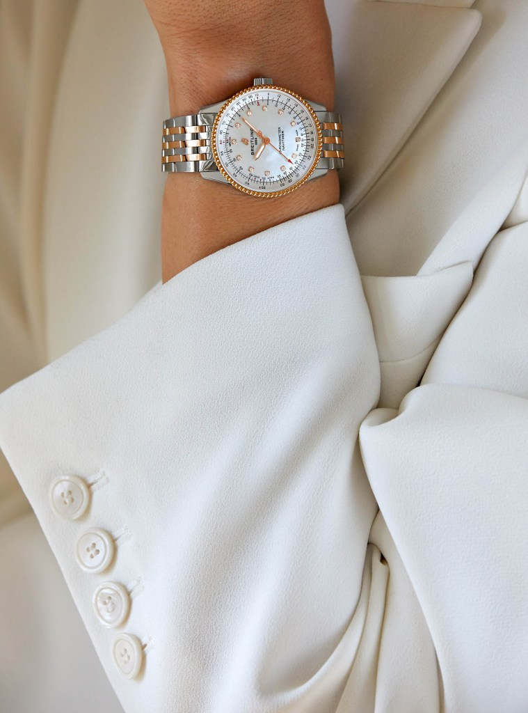 15 Female Model Wearing The Two Tone Navitimer Automatic 35 With A White Mother Of Pearl Dial With Diamond Hour Markers And An 18 K Red Gold Bezel 1 759x1024