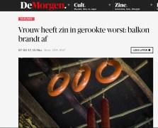 Vrouw heeft zin in gerookte worst, balkon brandt af