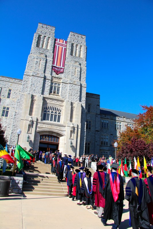 A parade of faculty members enters Burruss Hall for the installation of President Sands