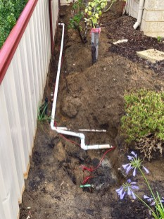 Connection in garden for sharing water bore with neighbour