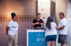 2018-7-28 Guests visit the resource fair to learn more about Hep C (Photograph by Erin Cuddigan)