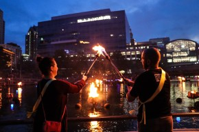 2018-7-28 RI Defeats Hep C torch bearers process down the steps to line the basin for a full lighting of WaterFire (Photograph by Yvonne Coyle)