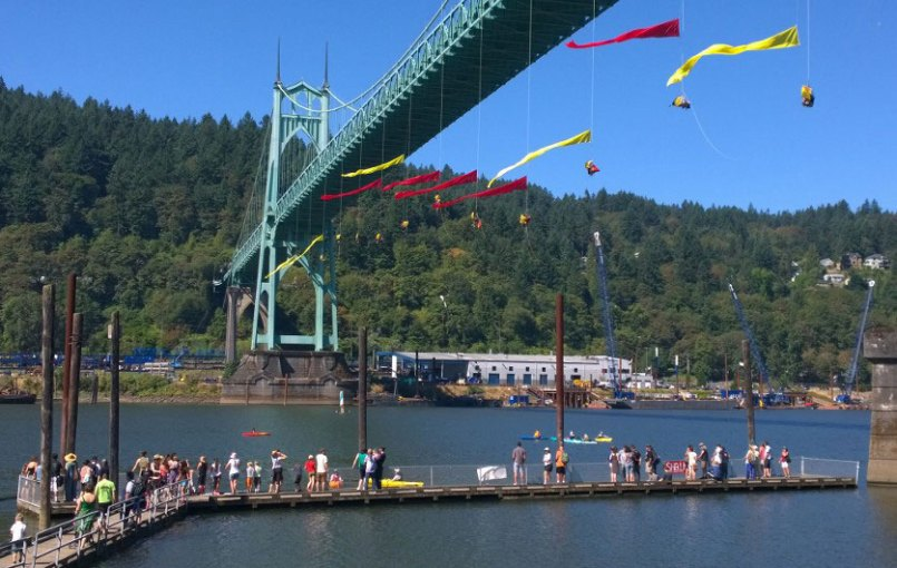 Greenpeace protest on the St. Johns Bridge with pennants flying