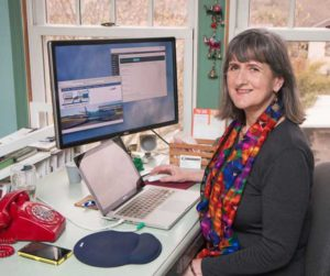Mary Ann Aschenbrenner in her Waterlink Web office
