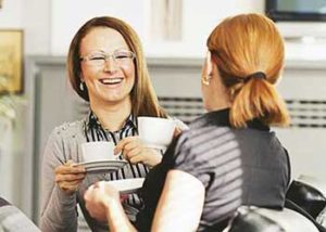 Two women enjoying coffee and discussing business.