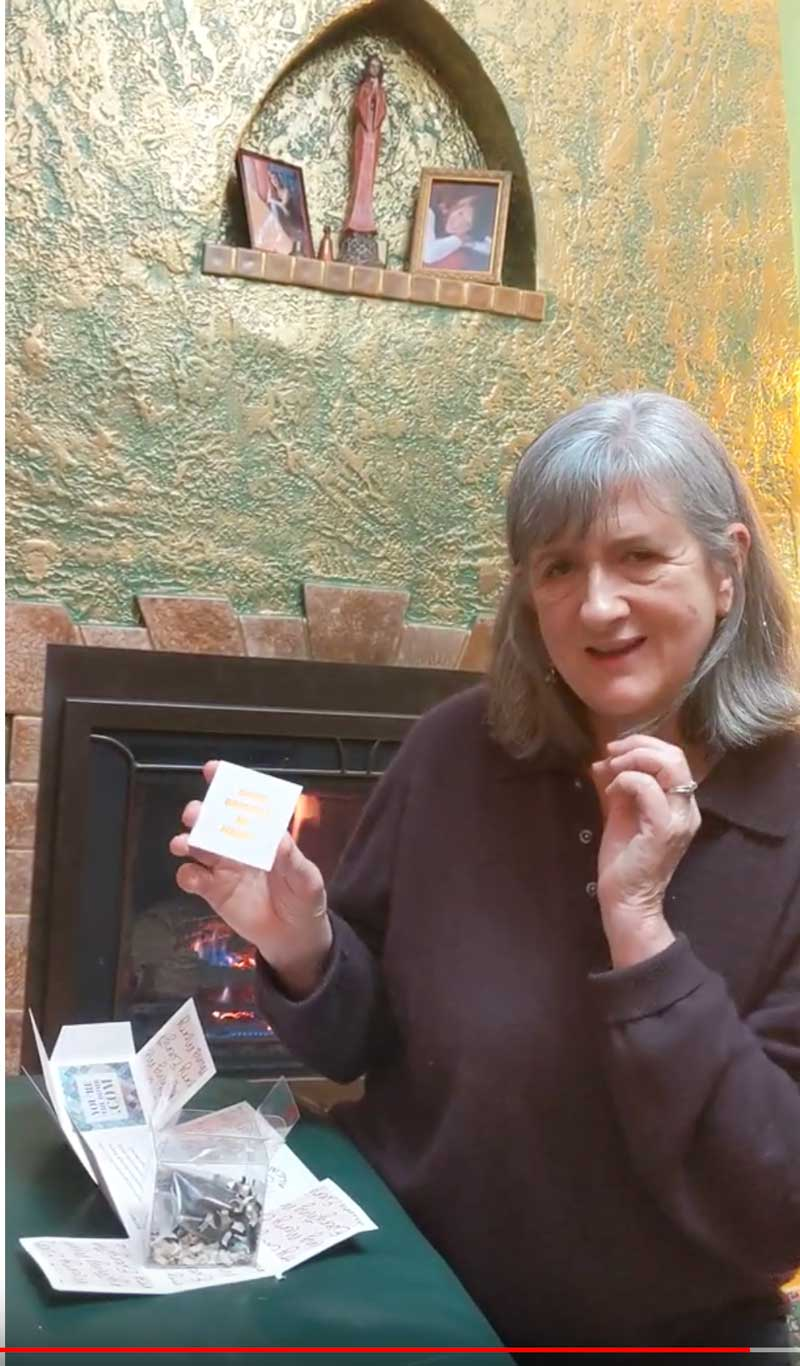 Mary Ann Aschenbrenner unboxing a Christmas surprise