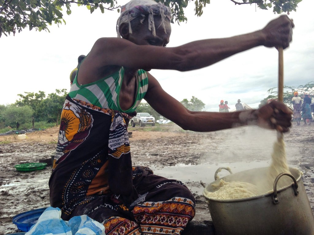 Woman in displacement camp cooks food