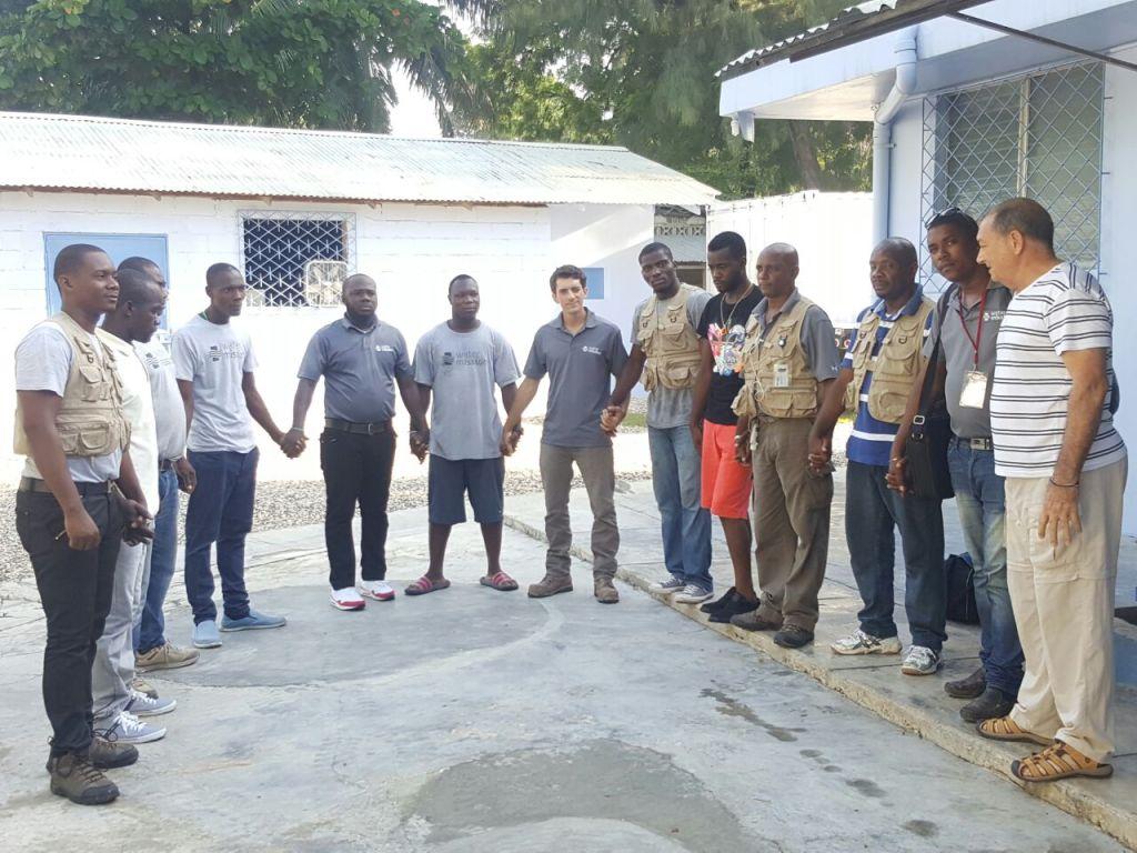Water Mission Haiti staff pray before heading into communities.