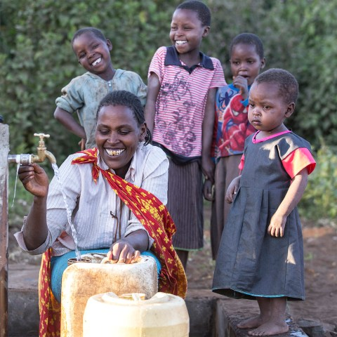 Mother and family collect safe water in jerry can | Enariboo, Kenya