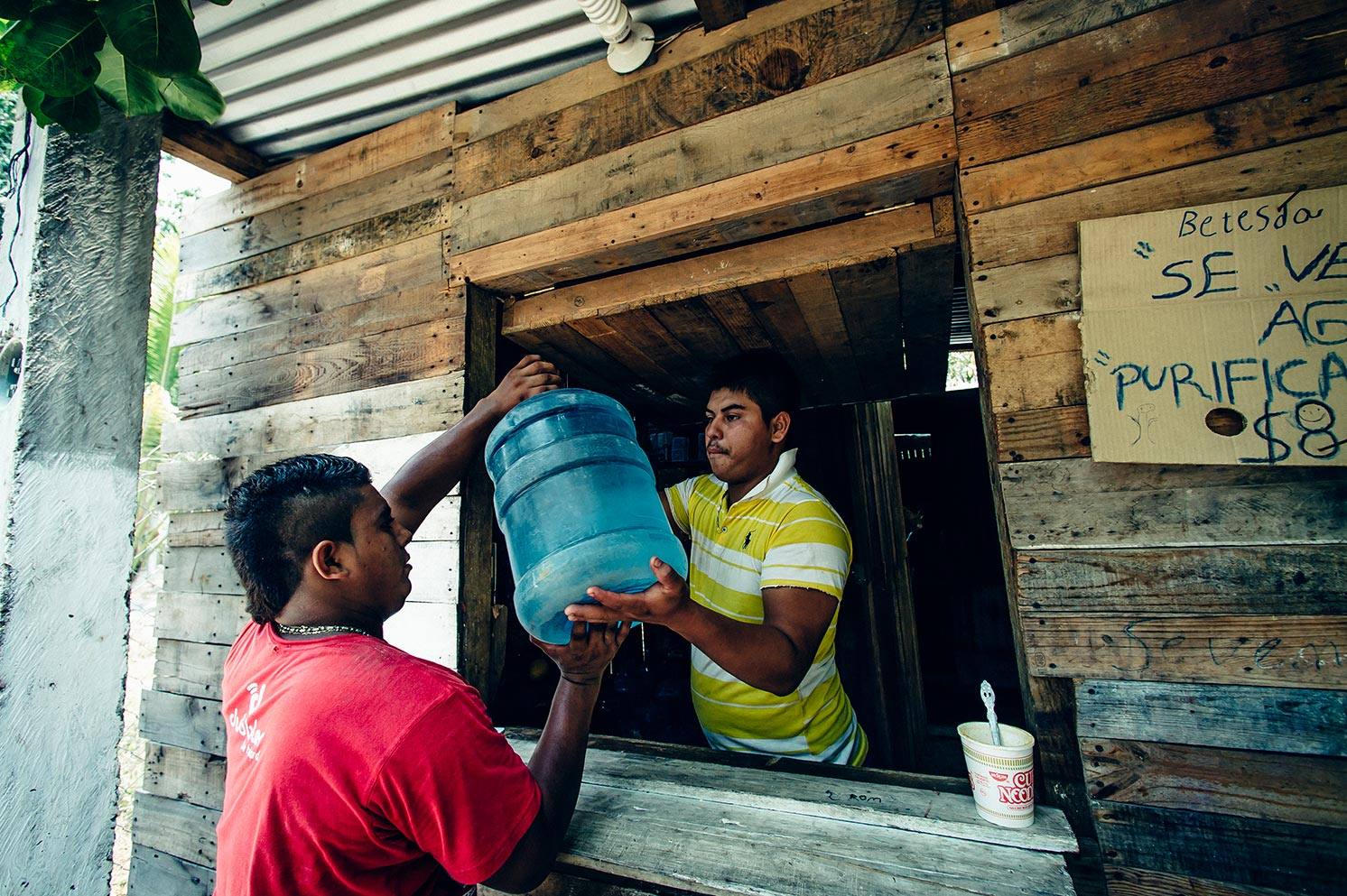 A man collects water to distribute to another community in Mexico.