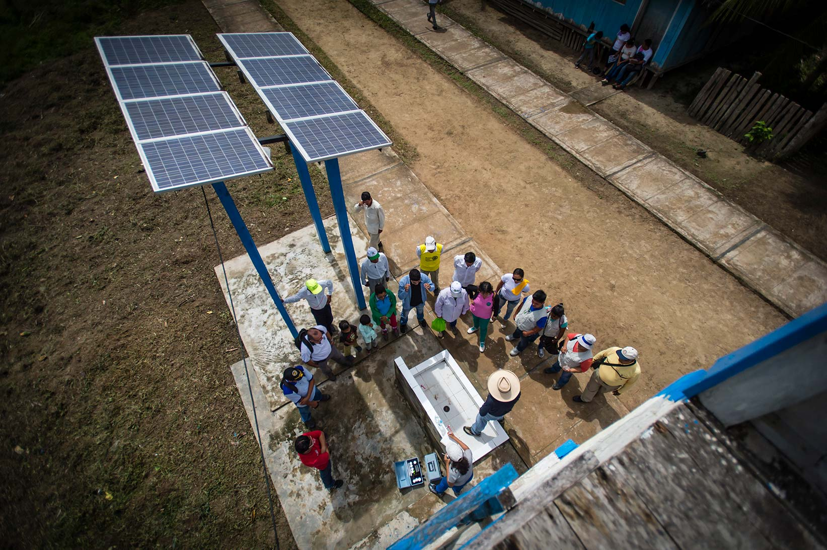 Solar panels power the safe water treatment system for Segundo and his family.