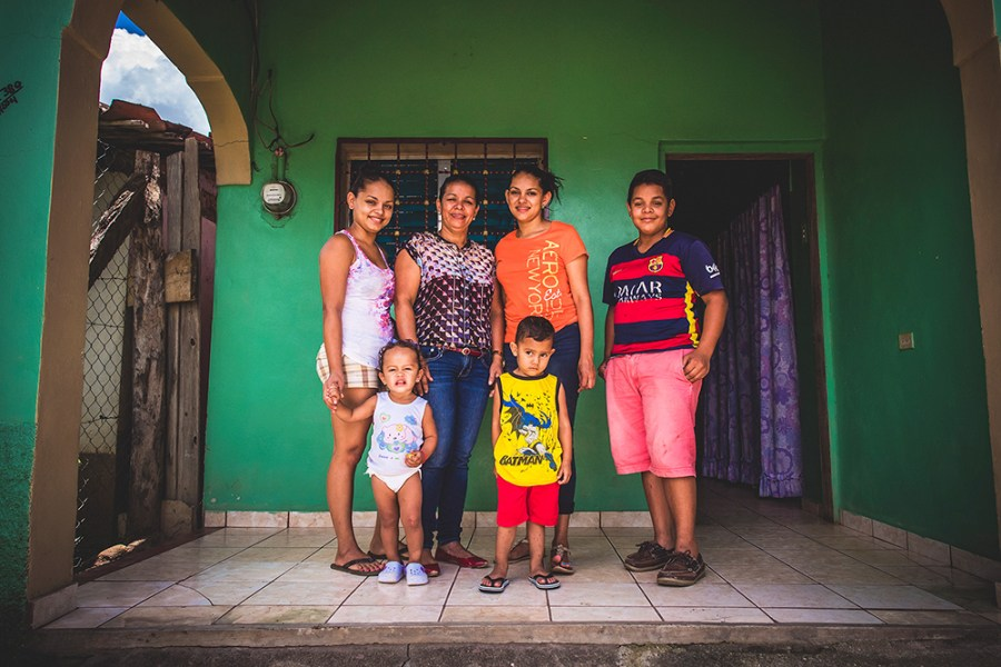 Ubelia Escobar with her three children and two grandchildren, who now have financial peace because of safe water.