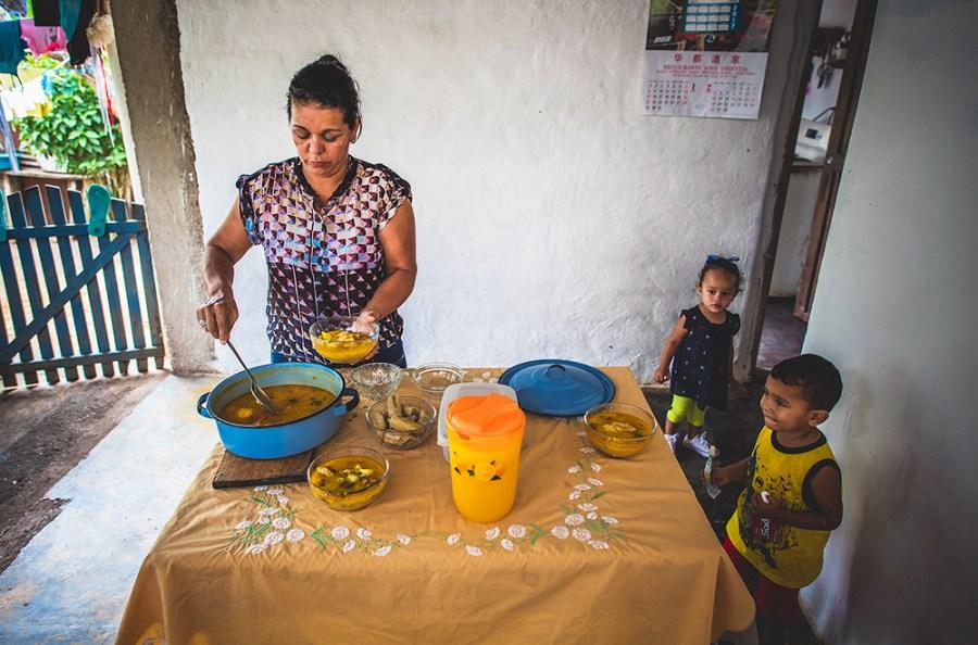 Ubelia prepares dinner for her family.