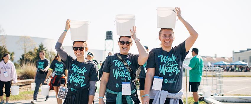 Girls carry buckets of water in Water Mission's Walk for Water.