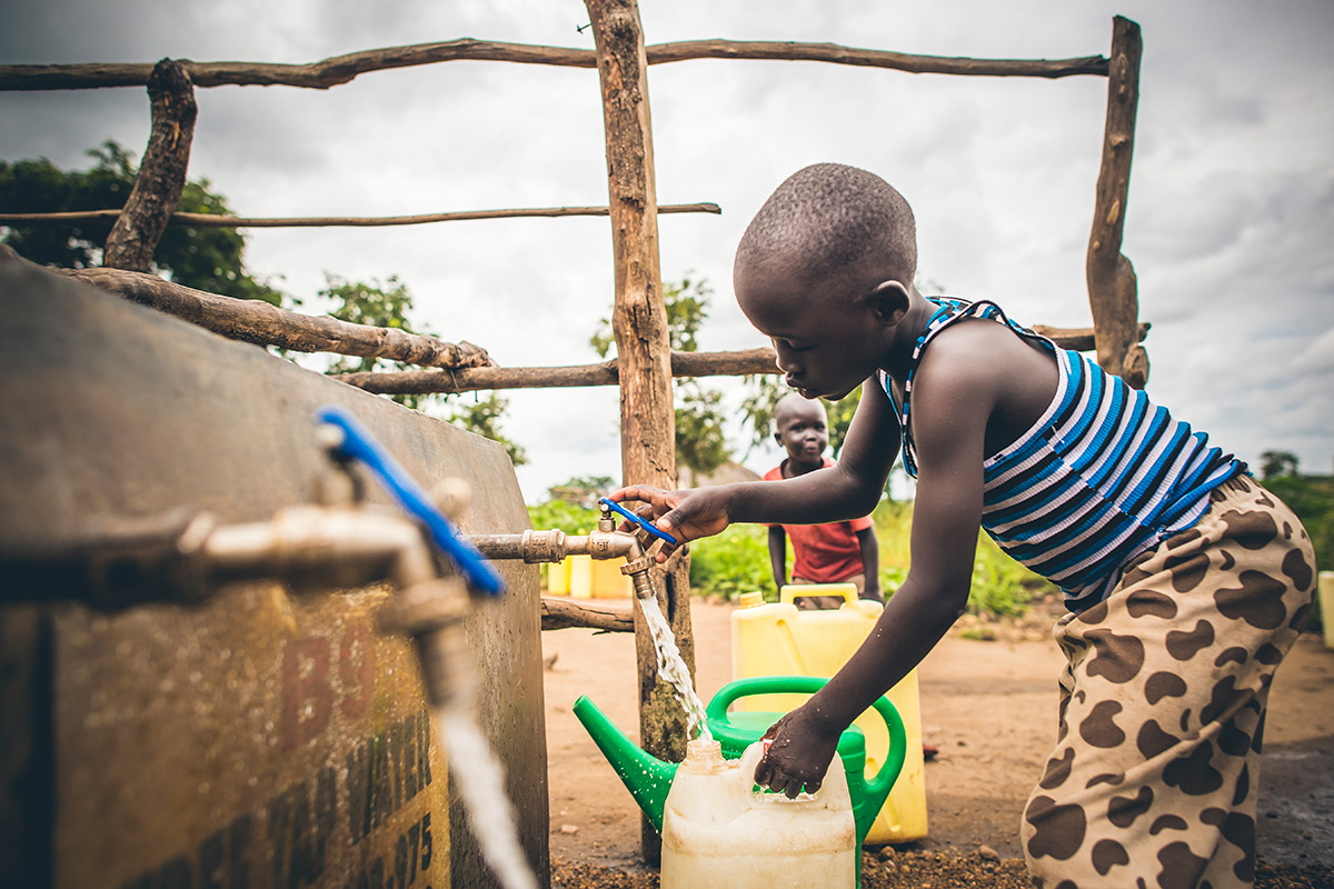 Drawing water from a Water Mission tap!
