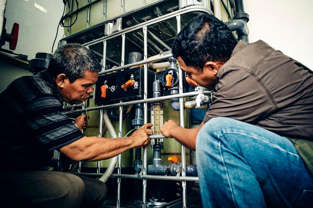 Water Mission Indonesia staff make repairs.