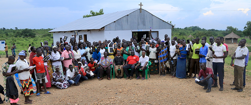 Participants receiving Bibles during the Trauma Healing Program.