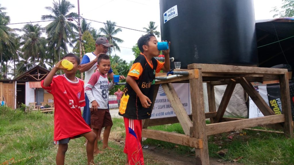 Children drinking safe water