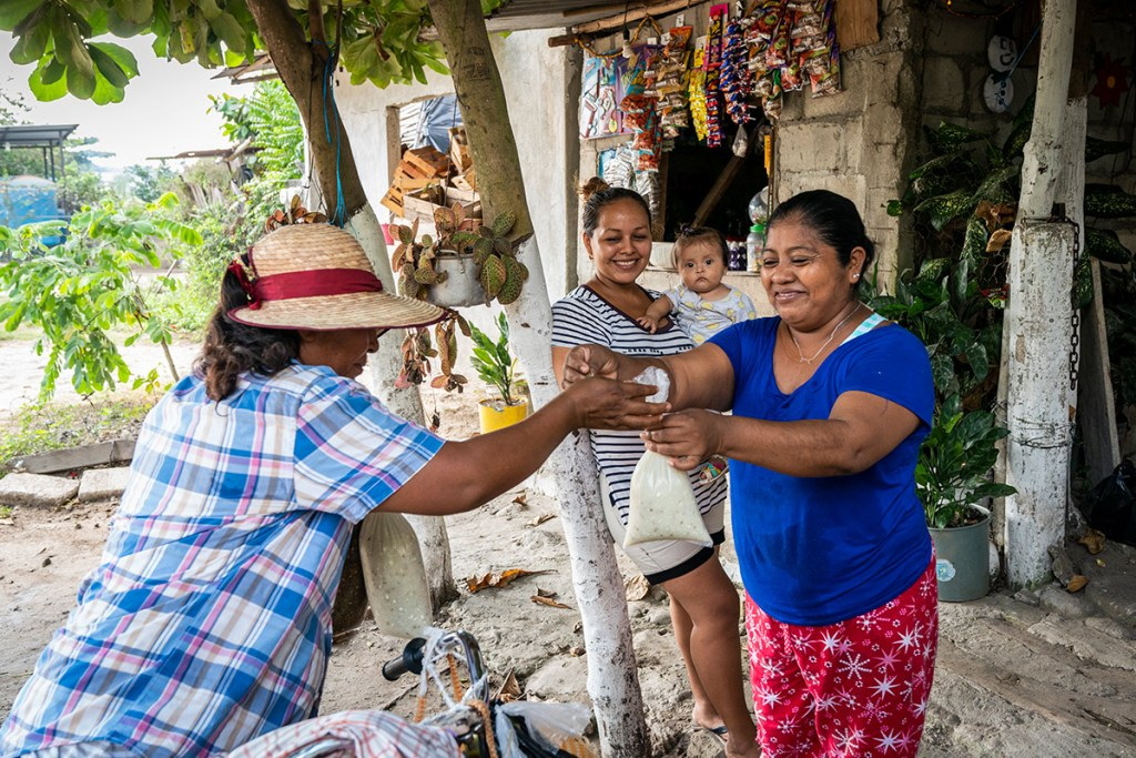 """Another local enterprise: Maritza Gomez Mendez, 46, is the maker of a corn drink called atole. She uses her income to pay for food and education for her children. """"I want my children to triumph,"""" she shared. She has about 120 regular customers!"""