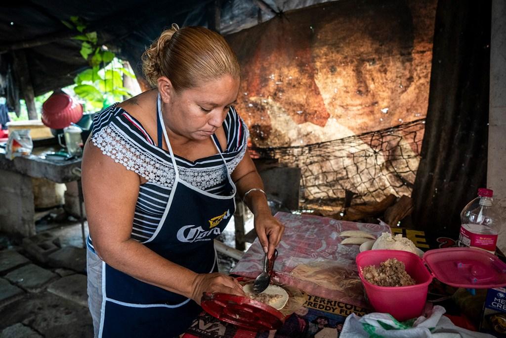 Reina preparing the restaurant's food