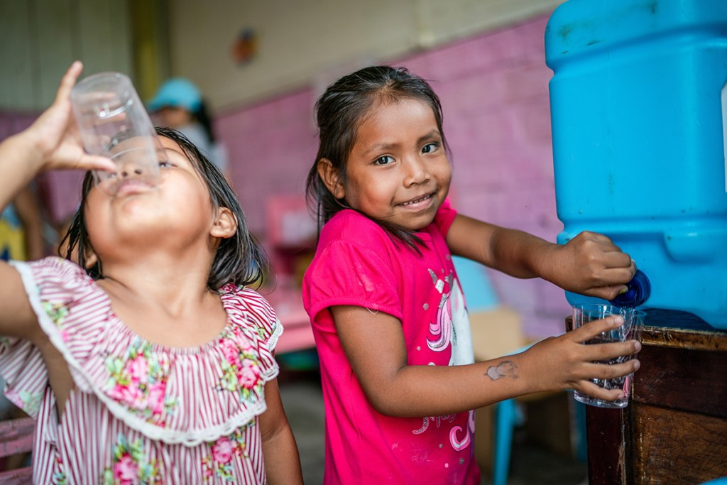 Children in the classroom drinking safe water
