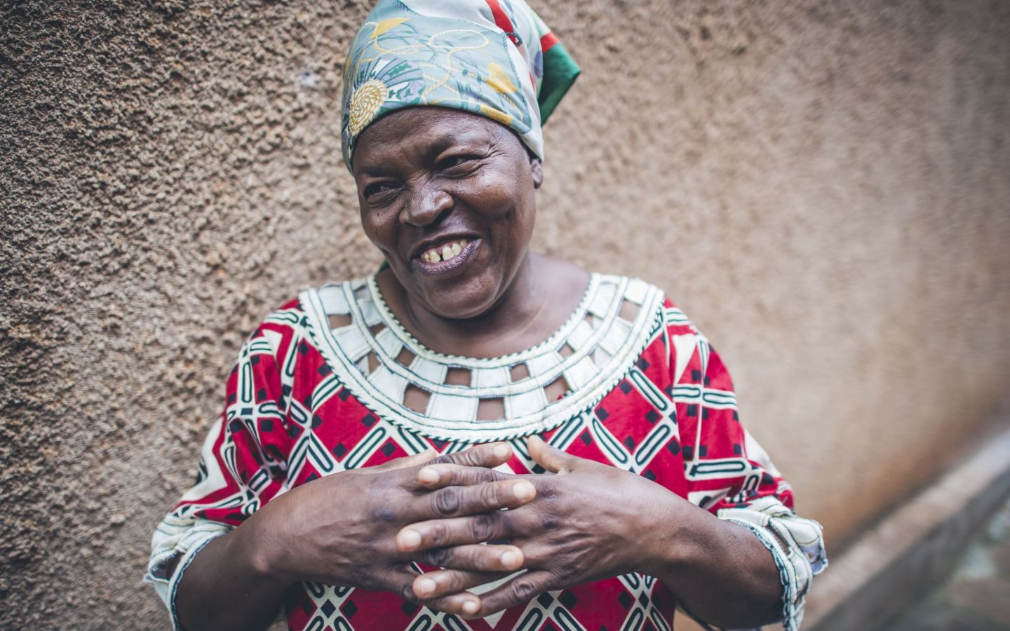 May 20, 2017 - Jaina Iddi Mwenda, 58, Community Health Officer for the government and WASH Coordinator for Water Mission in and around her home. Taken by Sean Sheridan, for Water Mission.