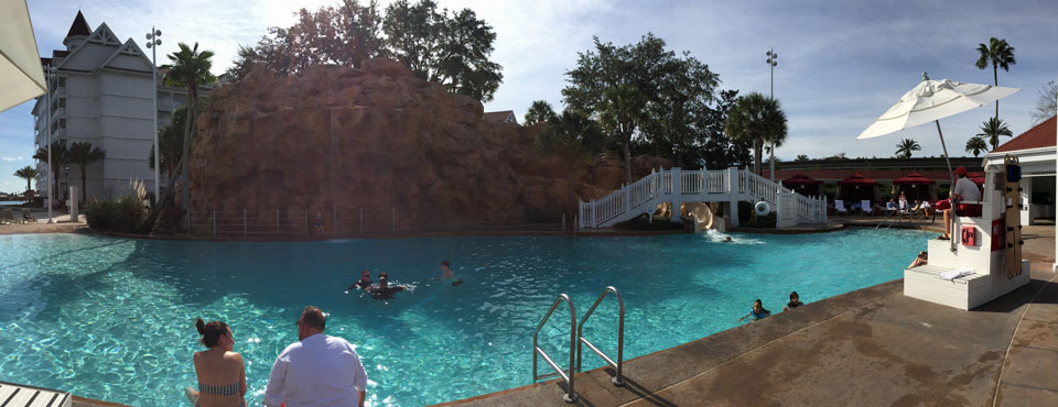 The pool and water slide at the Disney Grand Floridian with lifeguard on duty wide