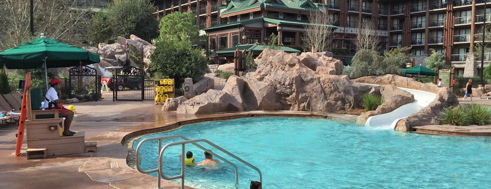 View of the Disney Wilderness Lodge Silver Springs Pool with Water slide and Lifeguard watching over 960