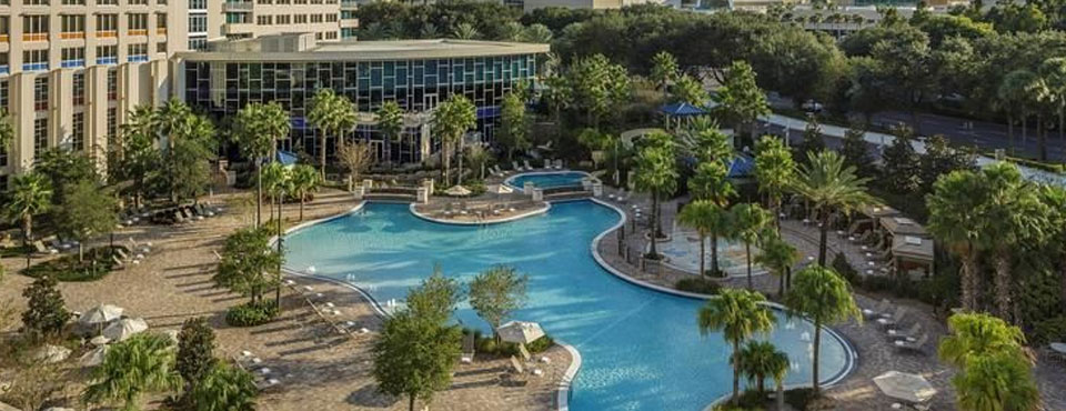 View of the back of the Hotel overlooking the large Grotto Pool at the Hyatt Regency Orlando on International Drive in Orlando Fl wide