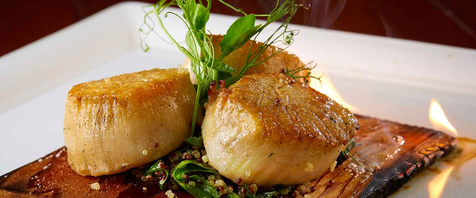 View of the Scallops prepared on a wood plank at the at the Deep Blu Seafood Grille at the Wyndham Grand Orlando 960