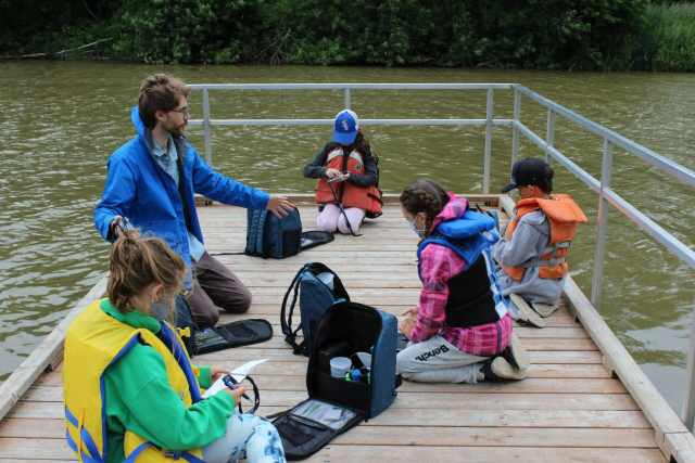 Luke, our education coordinator, talking with students on the dock