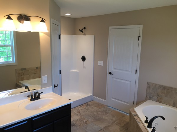 Shower, Jacuzzi, and His/her sinks overlooking Norris Lake