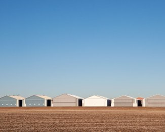 ROW OF HANGARS, 2013. Courtney Reints