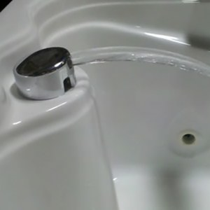 Cascading Fill and Drain Faucet