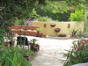 This lovely patio, fire ring, seating area and water feature replaced our old lawn