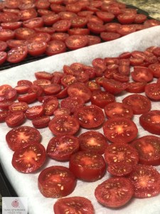 sliced tomatoes on parchment paper