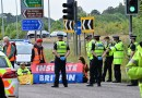 Climate protesters block A41 M25 roundabout with Police make arrests