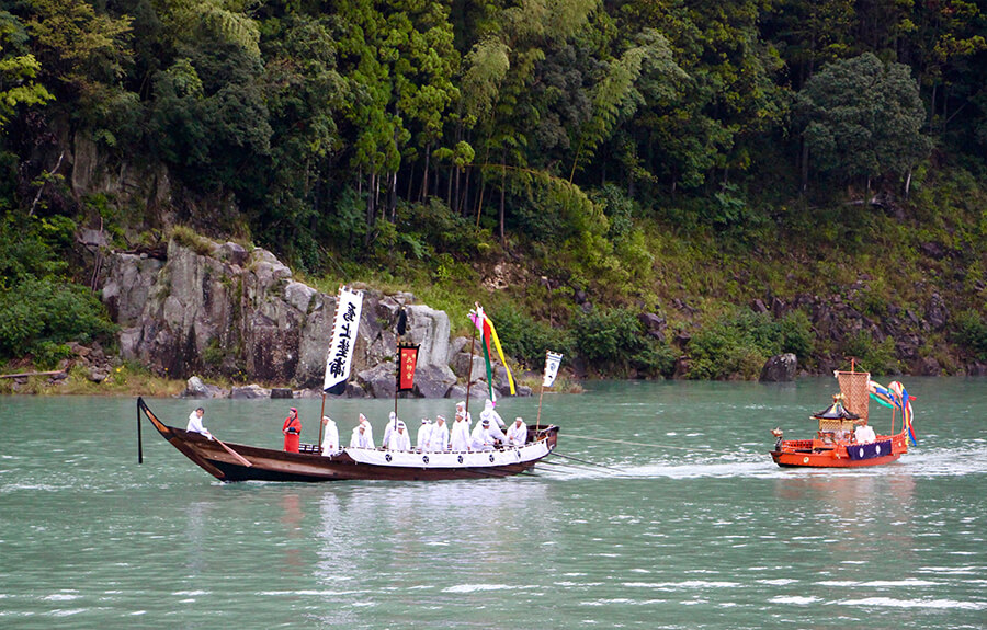 The divine spirit enshrined at Kumano Hayatama-taisha is transferred into a mikoshi (portable shrine) which is loaded onto a ceremonial boat.