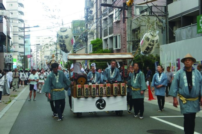 Kagura, a group of musicians moving with the mikoshi. Kagura is also the word for the music itself at matsuri.