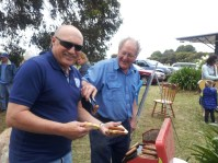 Chappy and Allan share a joke over the BBQ