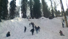 """""""People's sliding and having fun in snow (Muree, Pakistan)"""" by Noman Ahmed Awan - Own work. Licensed under CC BY-SA 4.0 via Wikimedia Commons."""