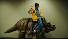 A child riding the Triceratops statue at the Creation Museum, run by Answers in Genesis founder Ken Ham